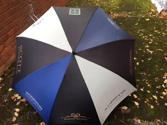Black Funeral umbrellas